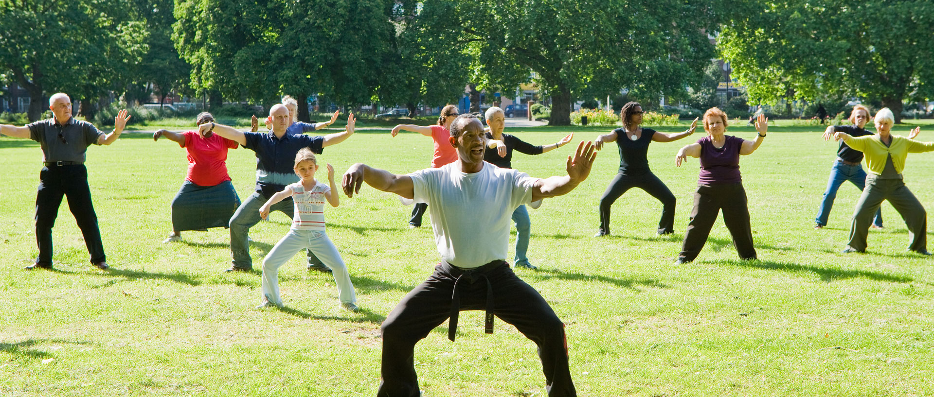 group of people doing tai chi