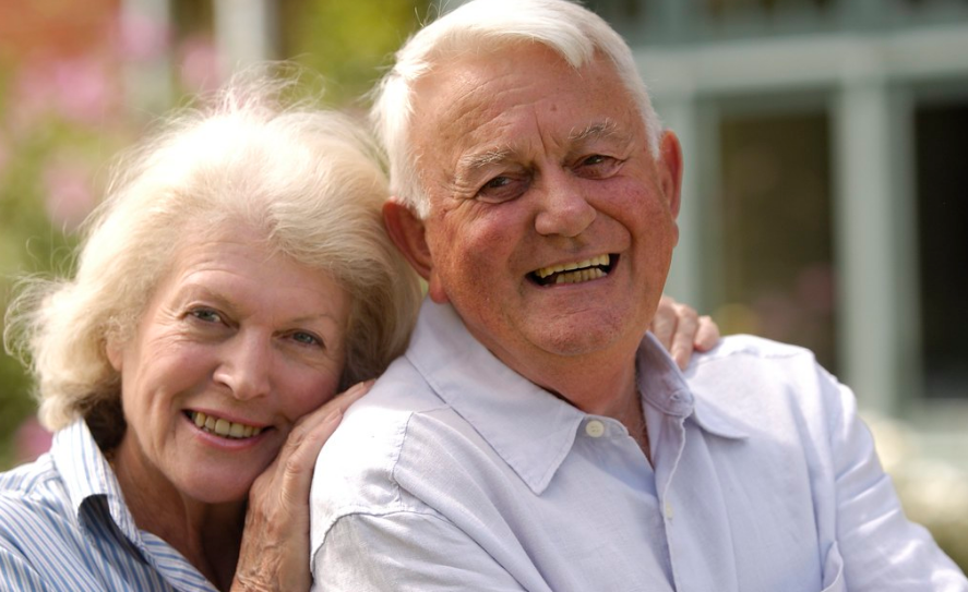 happy and smiling old couple