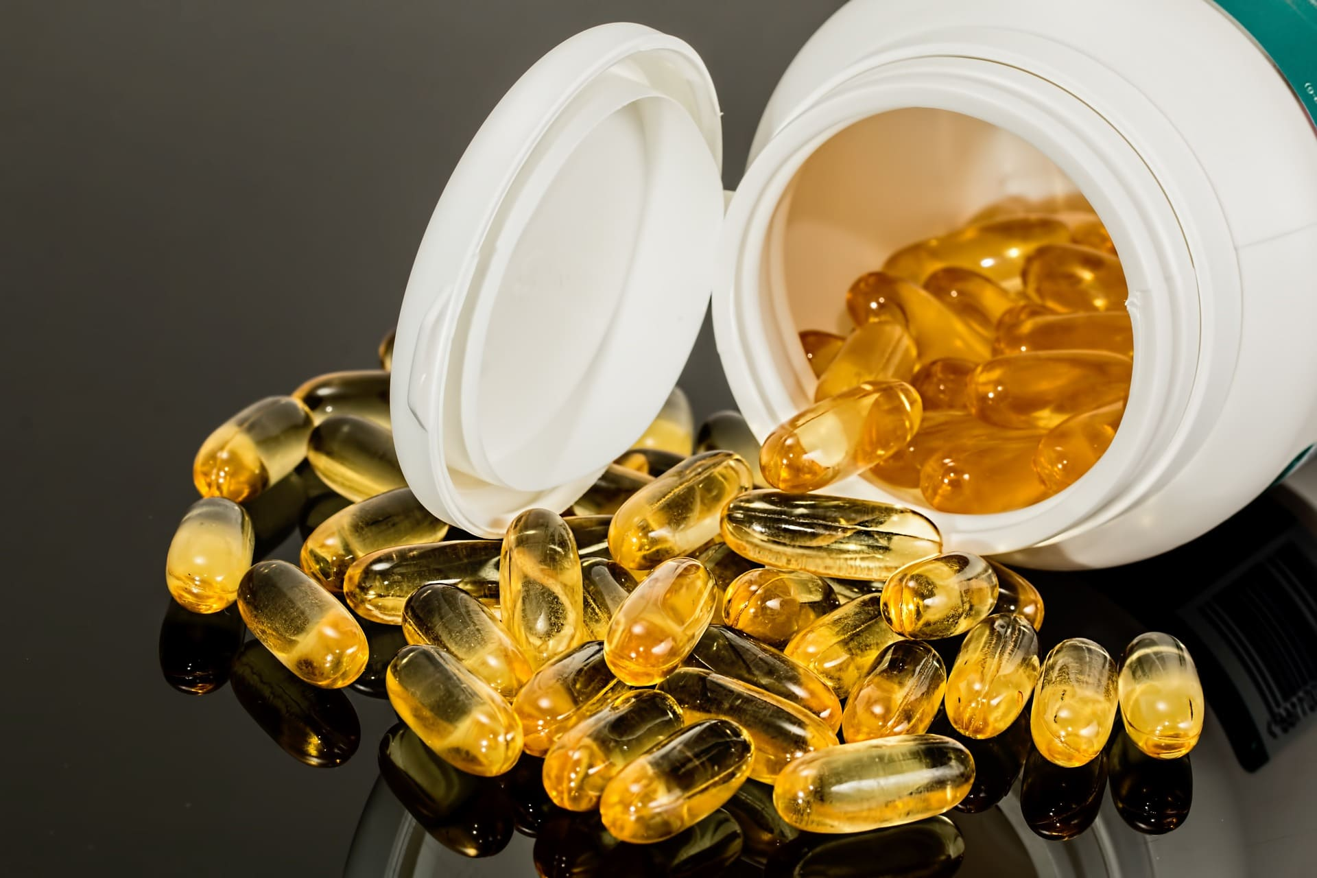 pills of the best vitamins for seniors swallowed on a white jar